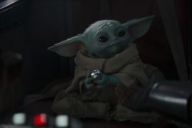 Baby Yoda listens to music on Mandalorian set