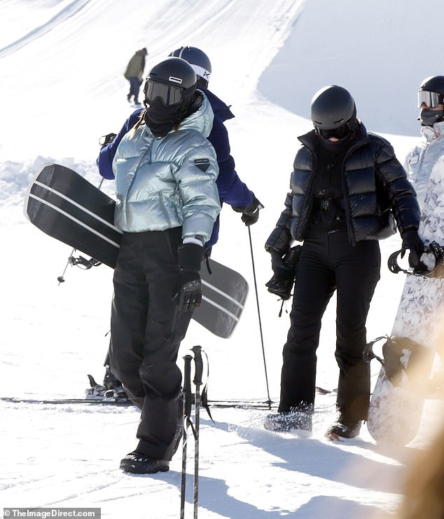 Looking good: Catwalker Kendall made a fashion statement in a Prada teal puffer coat and black skateboarding pants. I took safety very seriously and wore goggles and a helmet