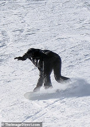 Yikes: As Kylie was speeding through the icy terrain she seemed to be trying to turn her board on but it hit a rough patch and looked like she had lost her feet