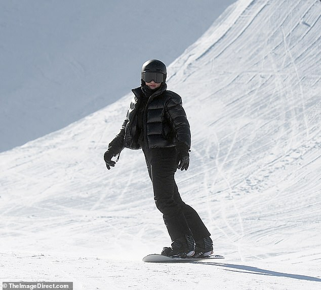 Snow Bunny: Kylie posed against a wintry white wearing the always classy black from head to toe with a black helmet and black goggles