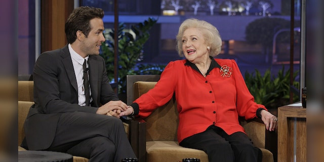 In the caption for his video, Reynolds (left) described his co-star in The Proposal Betty White (right) as