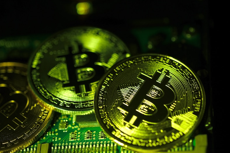 The visual representation of the Bitcoin digital currency (BTC) is arranged on the circuit board