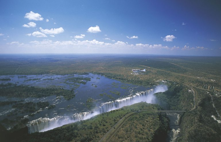 The distressing photo shows a man moments before drowning 350 feet to his death in Zimbabwe